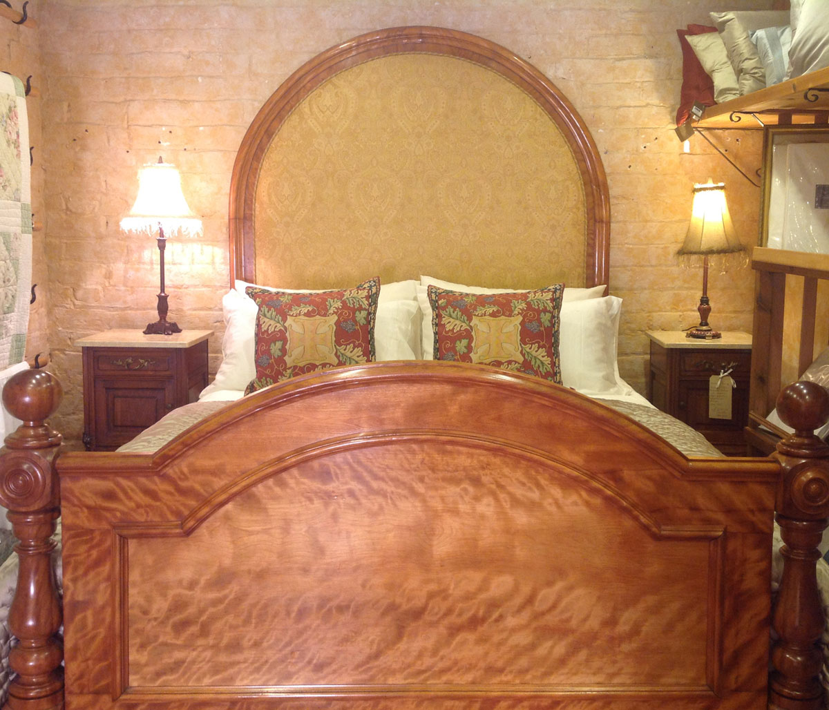 Upholstered arched antique wooden bed