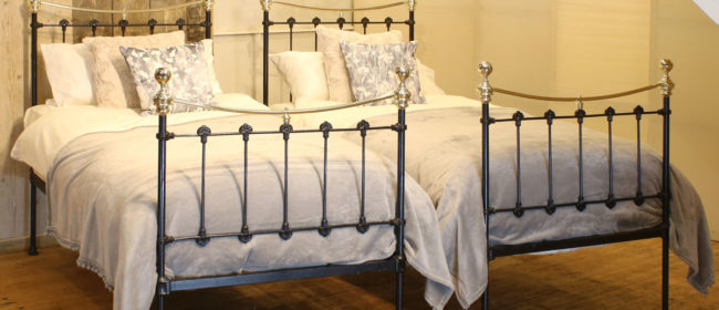 Matching Pair of Antique Beds in Black – MPS39